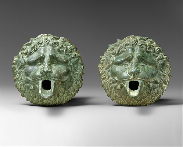 Bronze water spout in the form of a lion mask (one of a pair)