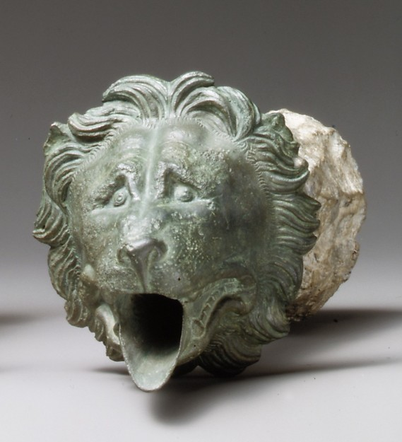 Bronze water spout with lion mask (one of a pair)