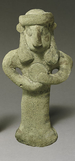 Standing figure holding a tambourine(?)