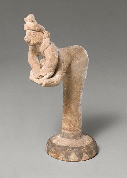 Female figurine kneading dough(?)