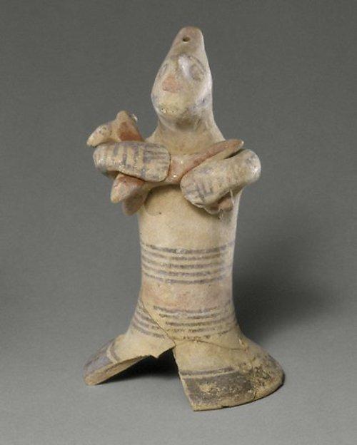 Terracotta statuette of a man holding a quadruped