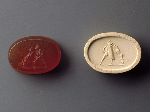 Carnelian intaglio of a gladiator fighting a lion