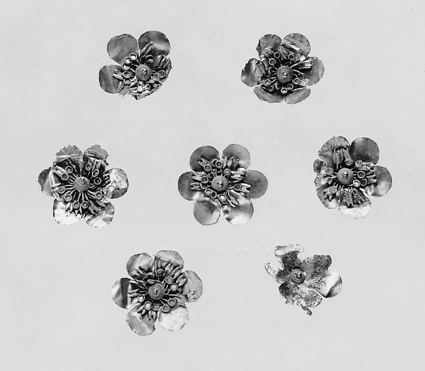 Seven gold rosettes