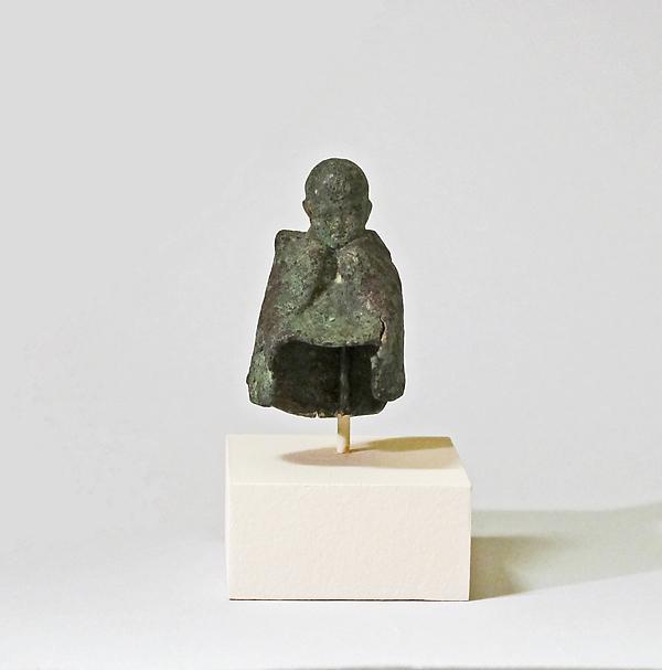 Fragmentary bronze statuette of boy wearing a mantle