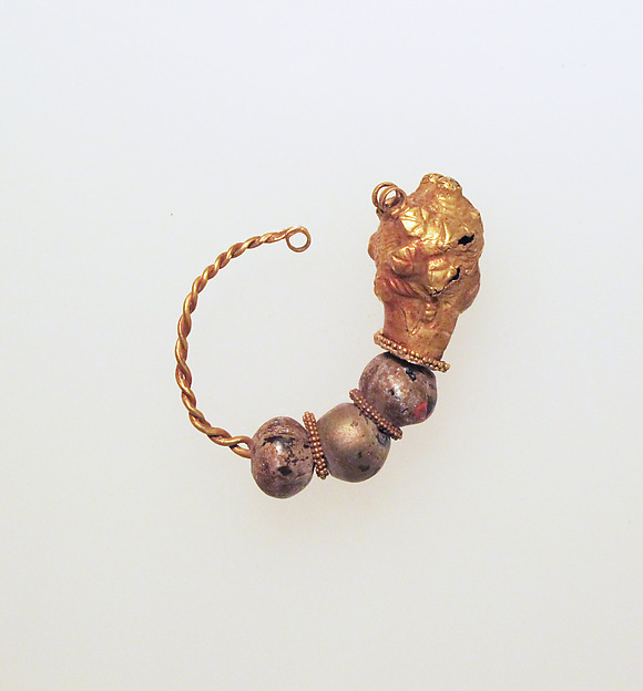 Gold earring with woman's head and glass beads