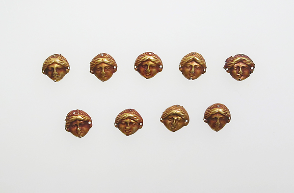 Bead ornaments in the form of female head