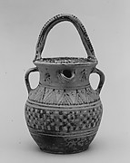 Terracotta vase with strainer, spout, and three handles