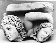 Upper right corner of a marble sarcophagus: head of an African (known as an Ethiopian) and a maenad