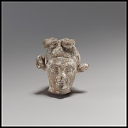 Terracotta head of a youth with a goat headdress