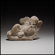 Terracotta statuette of Eros banqueting