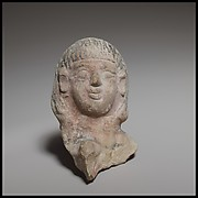 Female head, perhaps from a standing tambourine player