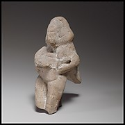 Seated female figurine