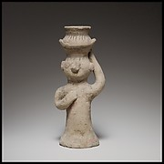 Standing female figurine holding an amphora on her head