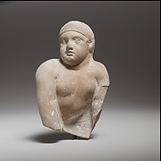 Terracotta statuette of a seated or crawling boy