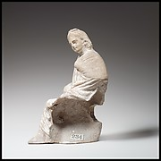 Terracotta statuette of a seated youth