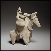 Terracotta statuette of a man riding a donkey