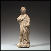 Terracotta statuette of a woman standing
