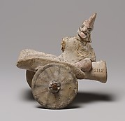 Model of a cart with a human figure