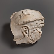 Fragmentary marble head of a helmeted soldier