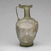 Glass double head-shaped jug