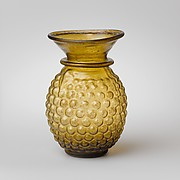 Glass jar with stylized grape decoration