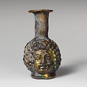 Glass double head-shaped bottle