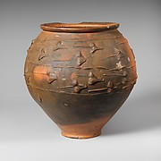 Terracotta jar with barbotine decoration