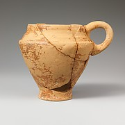 Terracotta carinated bridge-spouted jug