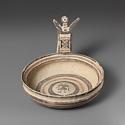 Terracotta bowl with vertical handle