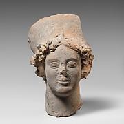 Terracotta head of a woman wearing a high headdress