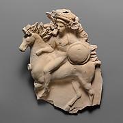 Terracotta relief of a horseman