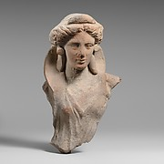 Terracotta fragment of the upper body of a woman