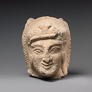 Limestone head of Herakles