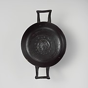 Terracotta stemless kylix (drinking cup)