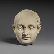 Limestone head of a boy