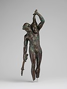 Bronze statuette of a satyr with a torch and wineskin