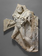 Marble relief with Herakles carrying the Erymanthian Boar