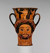 Terracotta kantharos (drinking cup) in the form of the heads of Herakles and of a woman