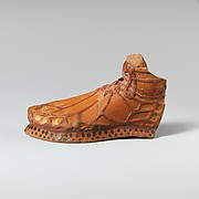 Terracotta aryballos in the form of a sandaled foot