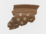Terracotta rim fragment with white inlay