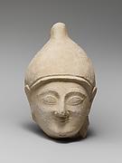 Limestone head of a man wearing a helmet