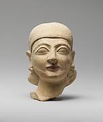 Limestone head of a man with a plain headdress