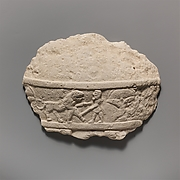 Fragment of a limestone statue of a male votary (worshipper)