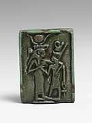 Faience amulet plaque of Isis nourishing a pharaoh