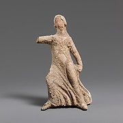 Terracotta statuette of a girl dancing