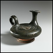 Terracotta guttus (flask with handle and verticle spout)