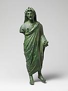 Bronze statuette of a priest sacrificing