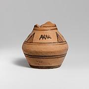 Fragmentary terracotta oinochoe (jug)