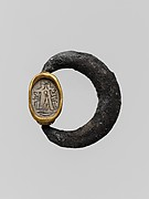 Silver swivel ring with glazed steatite scarab in a gold setting