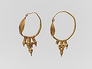 Pair of gold earrings with disk and pendant clustered spheres